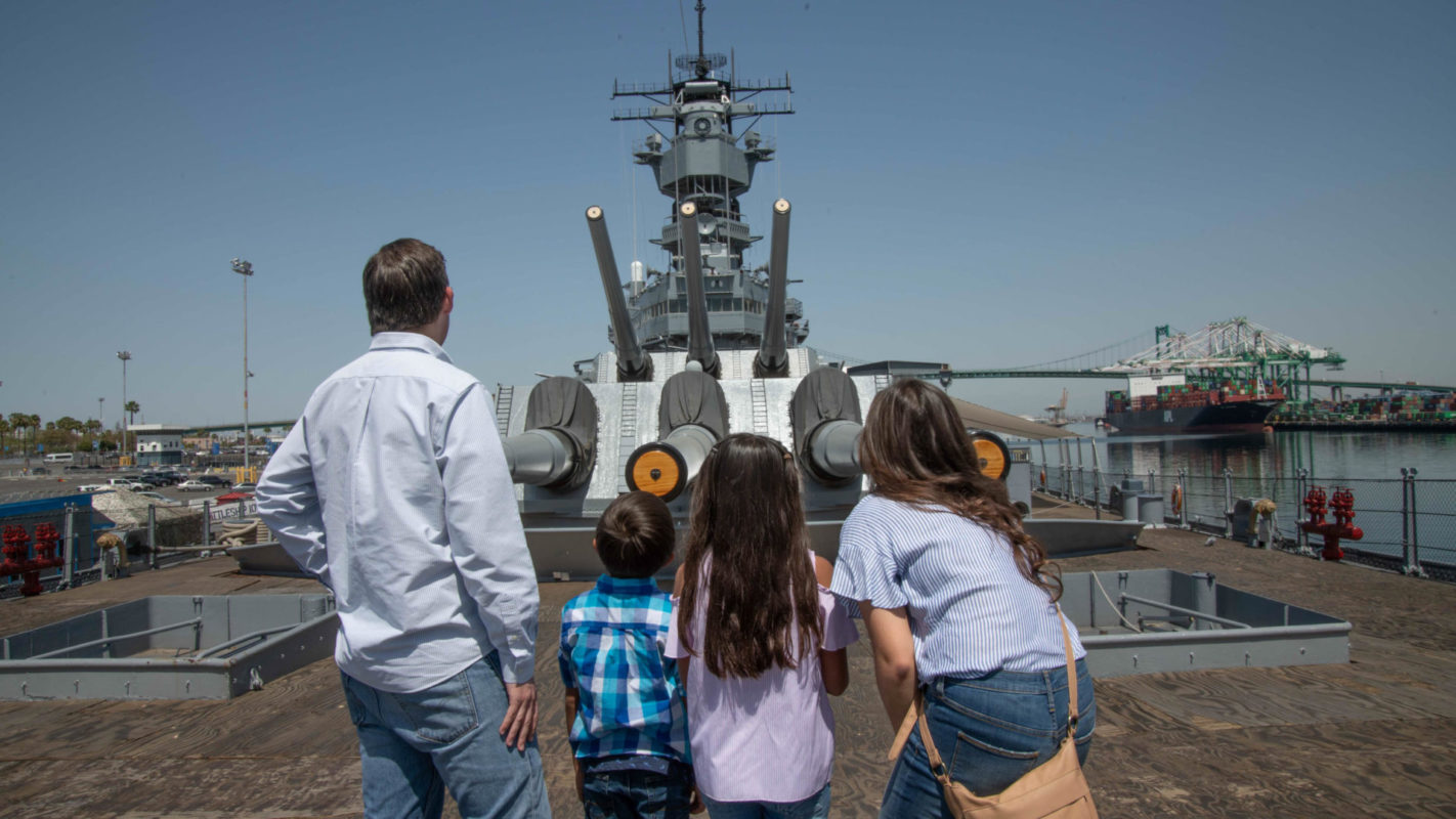 Family exploring USS Iowa